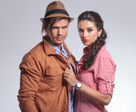 Woman pulling her boyfriend close to her Stock Images