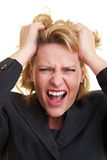 Woman pulling her hair Royalty Free Stock Photos