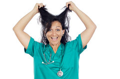 Woman pulling her hair. Young woman medical staff member pulling her hair Stock Image