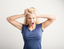 Woman pulling her hair out Royalty Free Stock Photography