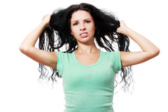 Woman pulling her hair Royalty Free Stock Images