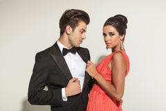 Woman pulling her lovers tuxedo Royalty Free Stock Image