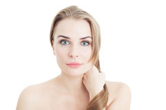 Woman pulling her strong hair as beauty concept Stock Photos