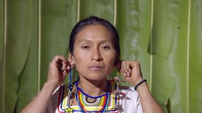 Woman pulling his ears. In Ecuador stock footage