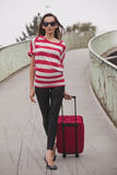 Woman pulling luggage Royalty Free Stock Photo