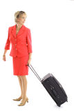 Woman pulling luggage on white. Shot of a woman pulling luggage on white Stock Photography