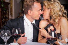 Woman pulling man into kiss. Woman pulling her  men into kiss Royalty Free Stock Photography