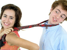 Woman pulling on man's tie Stock Photo