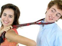 Woman pulling on man's tie Stock Photo