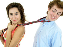 Woman pulling on man's tie Stock Photography