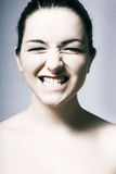 Woman pulling a massive grin Royalty Free Stock Image