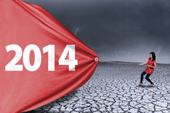 Woman is pulling new year of 2014 Royalty Free Stock Photo