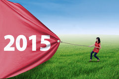 Woman pulling number of 2015 Stock Photos