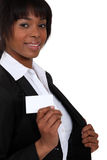 Woman pulling out a business card Royalty Free Stock Photo