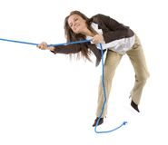 Woman pulling the rope stock photo