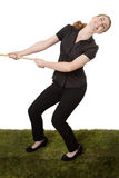 Woman pulling a rope tug of war Stock Photo