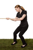 Woman pulling a rope tug of war Stock Image