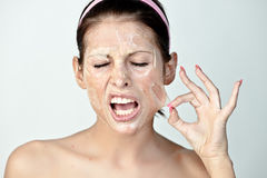Woman pulling on skin Stock Photos