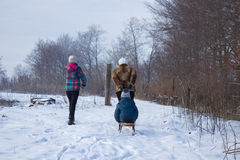 Woman pulling sled Royalty Free Stock Images