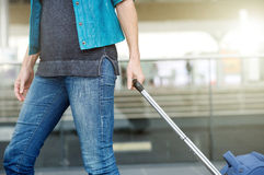 Woman pulling suitcase at airport Royalty Free Stock Images