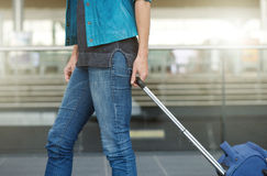 Woman pulling suitcase at train station Royalty Free Stock Image