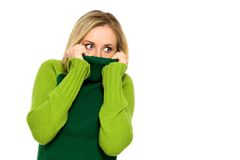 Woman pulling sweater over face Royalty Free Stock Photo