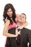 Woman pulling tie of man. Stock Photo