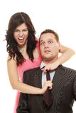 Woman pulling tie of man. Stock Photography