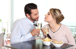 Woman pulling the tie to boyfriend, couple love concept Stock Images