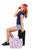 Woman pulling vacation suitcase talking on phone. Isolated on wh Stock Image