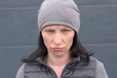 Woman pulling very grumpy face stock image