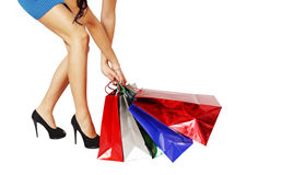 Woman pulls bags Royalty Free Stock Photos
