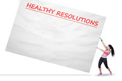 Woman pulls a board with healthy resolutions Royalty Free Stock Images