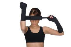 Woman Pulls Boxing Bandages Stock Photo