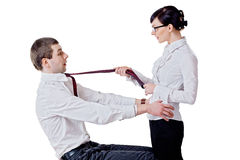 Woman pulls the man for a tie Stock Images