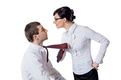 Woman pulls the man for a tie Royalty Free Stock Photos