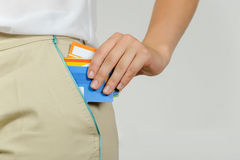 Woman pulls out of her pocket a plastic cards Royalty Free Stock Photos