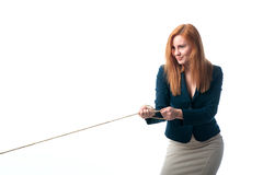Woman pulls the rope Royalty Free Stock Image