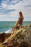 Woman Pulls Rope From The Sea After A Shipwreck Royalty Free Stock Photo