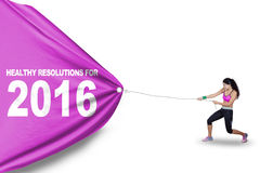 Woman pulls text of healthy resolution for 2016 Stock Photo