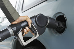 Woman Pumping Gas In Car Royalty Free Stock Photography