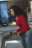 Woman Pumping Gas Into Car Royalty Free Stock Photo
