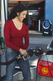Woman Pumping Gas Into Car Royalty Free Stock Photography