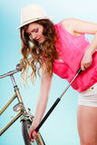 Woman pumping up tire tyre with bike pump. Stock Image