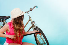 Woman pumping up tire tyre with bike pump. Stock Photography