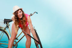 Woman pumping up tire tyre with bike pump. Stock Images
