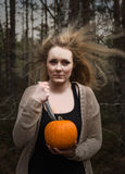 Woman with pumpkin and knife Royalty Free Stock Photo