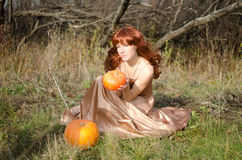 Woman with pumpkins Royalty Free Stock Image