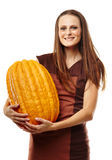 Woman with pumpkins Stock Photos