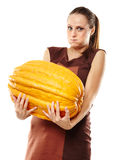 Woman with pumpkins Royalty Free Stock Photos